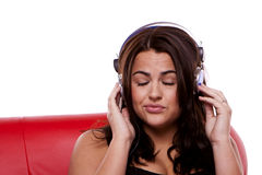 Young woman enjoying music. Royalty Free Stock Image