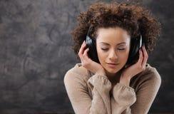 Young woman enjoying music Stock Image