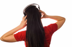 Young woman enjoying the music. (isolated on white stock photography
