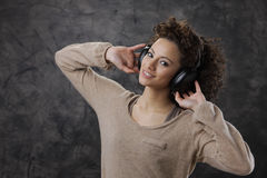 Young woman enjoying music Royalty Free Stock Image