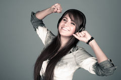 Young woman enjoying the music Stock Image