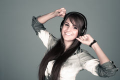 Young woman enjoying the music Royalty Free Stock Images