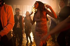 Young Woman Enjoying Music in Club stock photo