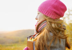 Young woman enjoying a music in the fall season. A Stock Photo