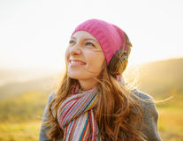 Young woman enjoying a music in the fall season Royalty Free Stock Photo