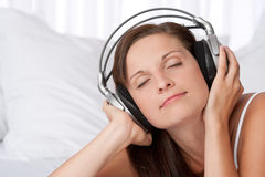 Young woman enjoying music with headphones Stock Photo