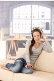 Young woman enjoying music through headphones Royalty Free Stock Images