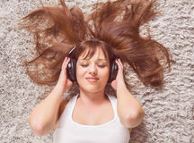 Young Woman Enjoying Music In Headphones Royalty Free Stock Photo