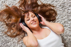 Young Woman Enjoying Music In Headphones Stock Images