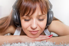 Young Woman Enjoying Music In Headphones Stock Photography