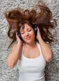 Young Woman Enjoying Music In Headphones Royalty Free Stock Images