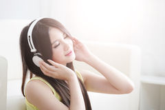 Young woman enjoying the music at home Stock Photo