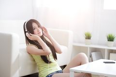 Young woman enjoying the music at home Royalty Free Stock Photography