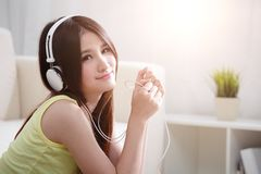 Young woman enjoying the music at home Royalty Free Stock Image