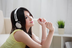 Young woman enjoying the music at home Royalty Free Stock Photo