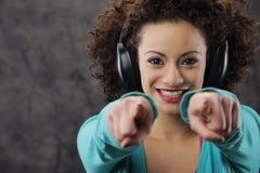 Young woman enjoying music Stock Images