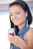 Young woman enjoying music smiling Royalty Free Stock Image