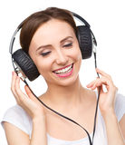 Young woman enjoying music using headphones Royalty Free Stock Image