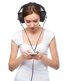 Young woman enjoying music using headphones Royalty Free Stock Images