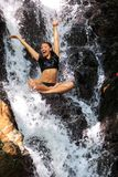 Young woman enjoying in natural tropical Waterfall Royalty Free Stock Images