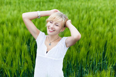 Young woman enjoying in nature Royalty Free Stock Photo