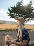 Young woman enjoying nature and sunlight in straw field royalty free stock photos