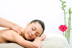 Young woman enjoying neck massage. Royalty Free Stock Photo