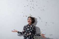Young woman enjoying the party with confetti. In air Royalty Free Stock Images