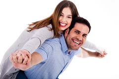 Young woman enjoying piggyback ride Stock Image