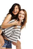 Young woman enjoying a piggyback ride Stock Photography