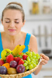 Young woman enjoying plate of fresh fruits Stock Image