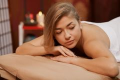 Young woman enjoying professional massage royalty free stock image