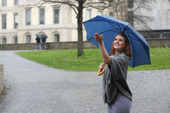 Young woman enjoying the rain Stock Images