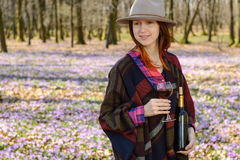 Young woman enjoying red wine outdoors royalty free stock photo