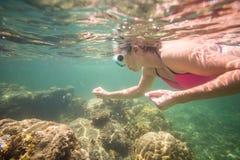Young woman enjoying reef in Indian Ocean Stock Photo