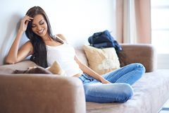 Young woman enjoying a relaxing day at home royalty free stock photos