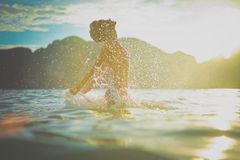 Young woman enjoying the sea. At sunset Stock Images