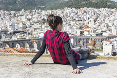 Young woman enjoying the sea view in Kavala,Greece. Sad woman looking the cityscape of Kavala,Greece stock photo