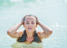 Young woman enjoying sea water Royalty Free Stock Images