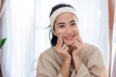 Free Young Woman Enjoying Self Face Massage Stock Photos - 127182123