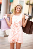Young Woman Enjoying Shopping Royalty Free Stock Image
