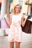 Young Woman Enjoying Shopping Royalty Free Stock Image