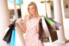 Young Woman Enjoying Shopping Stock Photography
