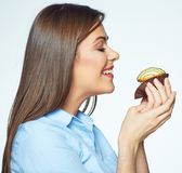 Young Woman Enjoying Smell Of Cookies With Closed Eyes Stock Image