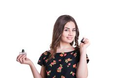 Young woman enjoying a smell of the perfume Royalty Free Stock Image