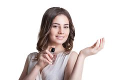 Young woman enjoying a smell of the perfume Royalty Free Stock Images