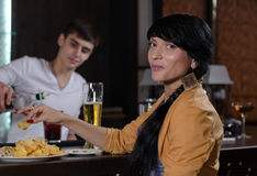 Young woman enjoying a snack at the bar stock photo