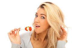 Young Woman Enjoying A Snack. Young woman enjoying a mozzarella and tomato snack stock photography