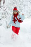 Young woman enjoying the snow Stock Photo