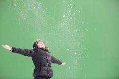 Young woman enjoying snow Stock Photography